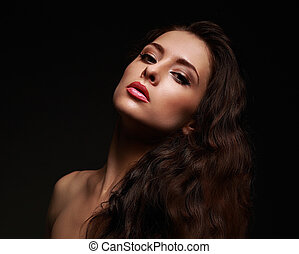 Beautiful makeup woman with long curly hair on black...