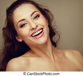 Beautiful makeup woman with long hair toothy smiling. Closeup