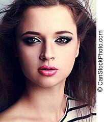 Beautiful makeup woman with pink lipstick and smoky eyes make-up. Closeup portrait