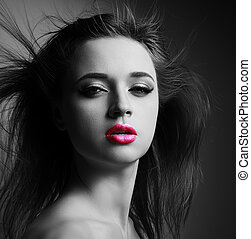 Beautiful makeup woman with pink lipstick and wild hair looking sexy. Art closeup portrait with shadows