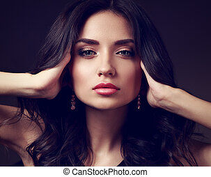 Beautiful makeup woman with pink lipstick and long curly hair looking calm. Closeup fashion portrait. Toned art