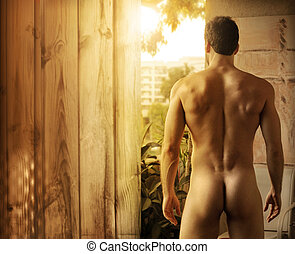 Beautiful male body - Naked beautiful muscular man standing...