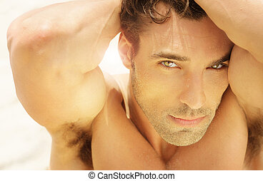 Beautiful man face - close-up warm detailed portrait of...