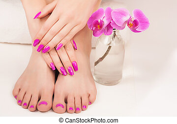 beautiful manicure and pedicure on the white
