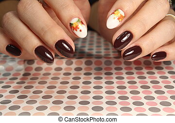 Beautiful manicure design brown with a pattern