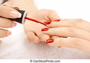 Drawing of a red varnish on the nails, isolated on a white background