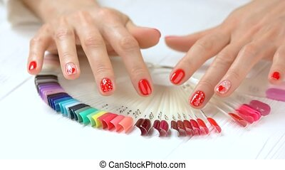 Beautiful manicured hands and nail samples. Young woman...