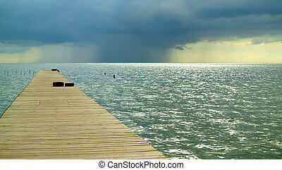 Beautiful marine landscape with a wooden bridge.