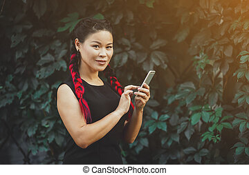 Beautiful Mature Asian Female Model with Smartphone Outdoor