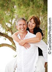 Bright lifestyle portrait of a beautiful mature couple having fun.