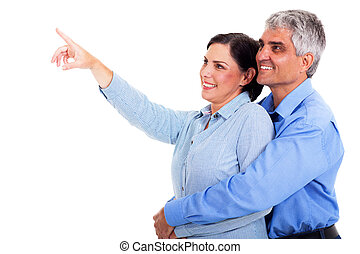 mature couple pointing