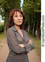Beautiful mature woman outdoors portrait