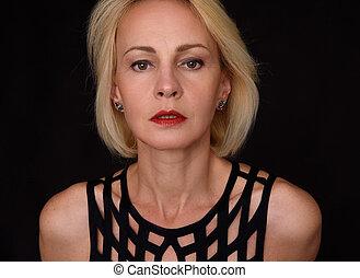 beautiful mature woman portrait on black