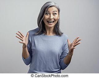 Beautiful mature woman posing in studio