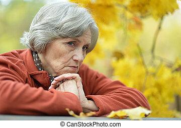 beautiful mature woman posing outdoors