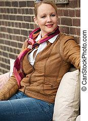 Beautiful mature woman smiling outdoors