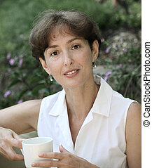 Beautiful mature woman with a cup of coffee