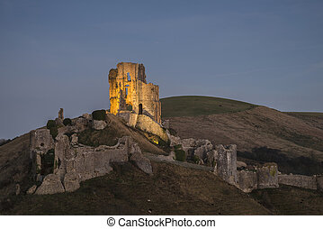 Beautiful Medieval castle ruins in Autumn landscape at dusk