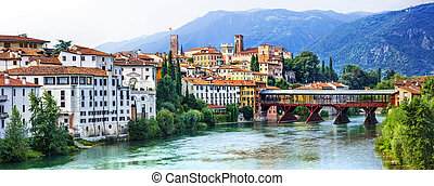 Beautiful medieval towns of Italy -picturesque Bassano del Grappa .Scenic view with famous bridge. Vicenza province, region of Veneto