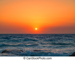 Beautiful Mediterranean sea orange sunset.