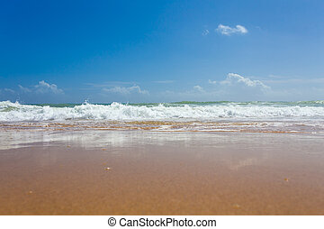 Beautiful mediterranean water lapping on the shore -...