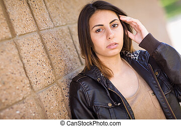 Beautiful Meloncholy Mixed Race Young Woman Portrait Outside.