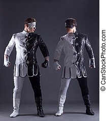 beautiful men posing in masquerade costumes