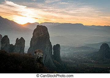 Meteora monasteries in sunset in Greece. - Beautiful Meteora...