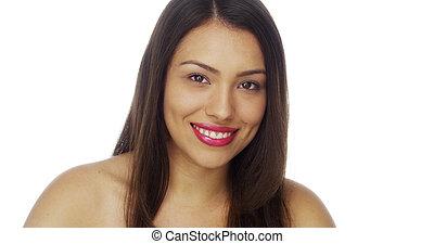 Beautiful Mexican woman looking at camera