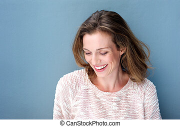 Beautiful mid adult woman laughing with sweater - Close up...