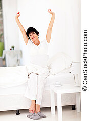 beautiful mid age woman getting up in the morning