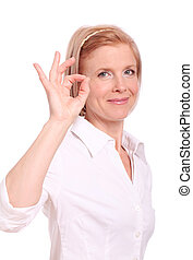Beautiful mid aged woman showing ok gesture on a white...