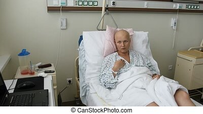woman patient with cancer in hospital - beautiful middle age...