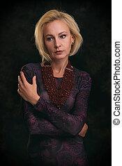 Beautiful middle aged sad blonde woman portrait