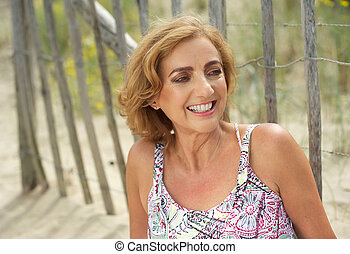 Beautiful middle aged woman relaxing outdoors