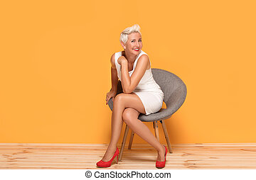 Beautiful middle aged woman smiling, relaxing.