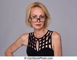 beautiful middle aged woman wearing glasses