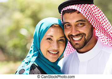 beautiful middle eastern couple - close up portrait of...
