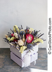 beautiful mini bouquet lavender and dry flowers on table .