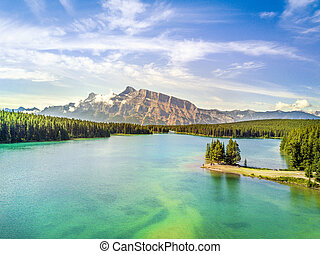 Beautiful Minnewanka Lake with small peninsula, Banff National Park, Alberta, Canada