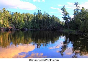 Beautiful mirror smooth Minnesota lake at sunset