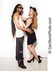 Beautiful mixed couple in loving embrace
