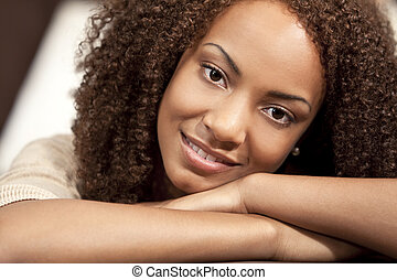 Beautiful Mixed Race African American Girl Resting On Her Hands