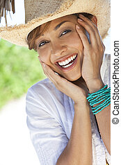 Beautiful Mixed Race Woman Laughing In Straw Coboy Hat