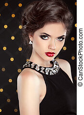Beautiful model brunette with red lips and hairstyle. Fashion gl