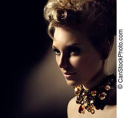 Beautiful model girl with perfect fashion makeup and hairstyle