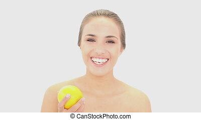 Beautiful model holding an orange