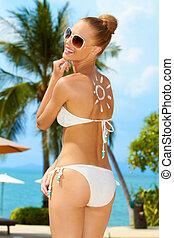 Beautiful model in bikini laughing
