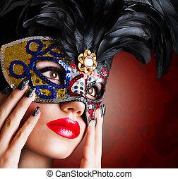 Beautiful model in carnival mask