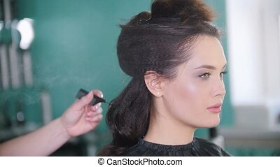 Beautiful model in the professional hair salon, slow motion